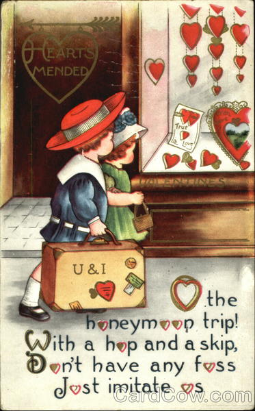 Boy holding suitcase, girl holding purse, walking by store window with red heart