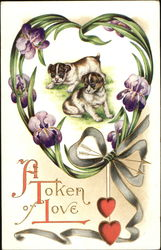 Two puppies surrounded by heart of leaves and flowers