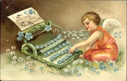 Cupid typing a letter