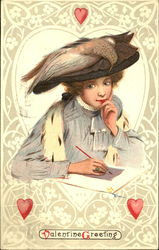 Woman in big brown hat with bird on it, writing