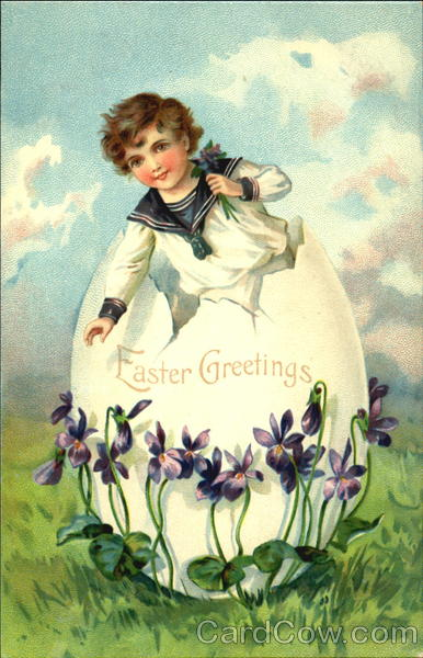 Boy standing in a huge Easter egg and holding flowers