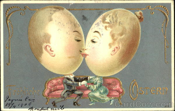 2 people with large egg heads sitting on couch Eggs