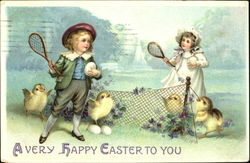 Boy and girl with tennis rackets, net, 4 chicks