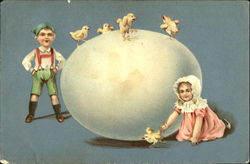 Boy and girl with chicks and a huge egg