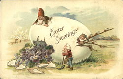 Gnomes, on top of egg, one peeking out, one just broke egg Postcard