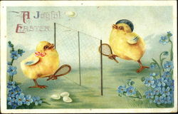 Two chicks playing badminton with eggs