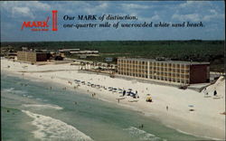 Our Mark of distrinction, one-quarter mile of uncrowded white sand beach
