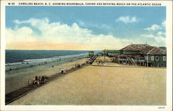 Boardwalk, casino and bathing beach on the atlantic ocean Postcard