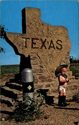 Baby Cowboy Standing in Front of Texas Stone Marker