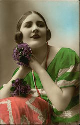 Woman in Green Dress holding Violets
