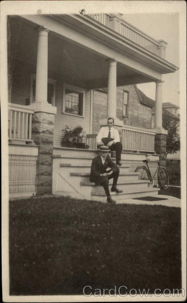 Two Men Sitting on the Front Porch Steps