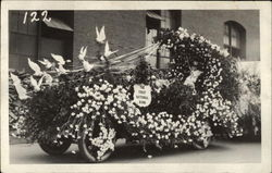 The First National Bank, flowered parade float