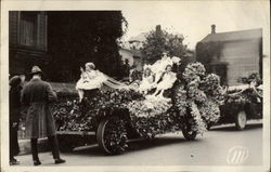 Girls Riding a Parade Car