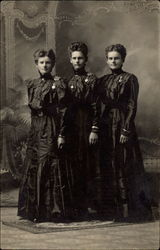 Three Women in Black Dresses