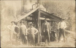 Laborers Posed Beside a Machine
