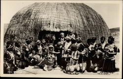 Nude African Tribe in front of hut