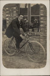 A Man Astride His Bicycle