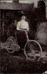 A Woman With Her Bicycle