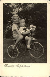 German Kids on Tricycle