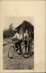 Two Men with Their Bicycles
