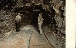 Gangway in Mine with two miners