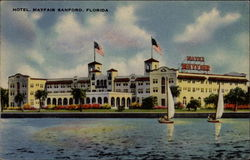 Hotel Mayfair, Sanford, FL, seen over water with sailboats Postcard