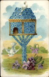 Blue floral birdhouse with doves