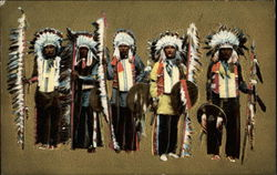 Five Native American chiefs in full regalia and feathered headdresses