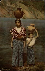 Girls carrying water Jugs on heir Heads