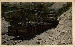 Loaded Coal Cars being drawn from slope by steel cable