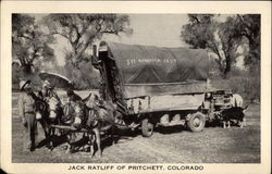 Jack Ratcliff, mules and small covered wagon, b&w photo