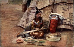 Abenaki woman woman outside tepee, with papoose