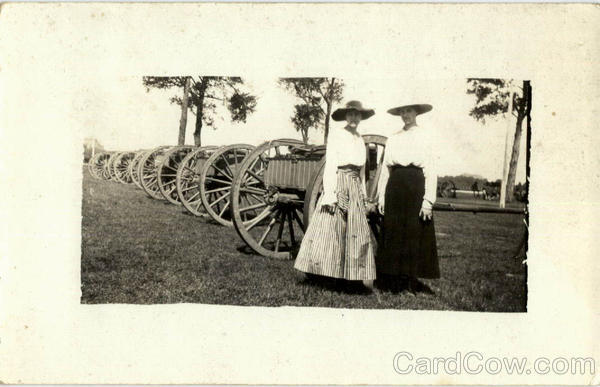 Two Women standing in front of wagons