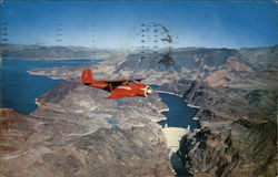 Plane Over Hoover Dam and Lake Mead