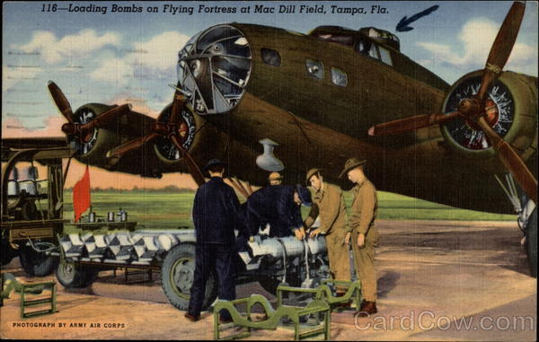 Loading Bombs on Flying Fortress at Macdill Field Tampa Florida