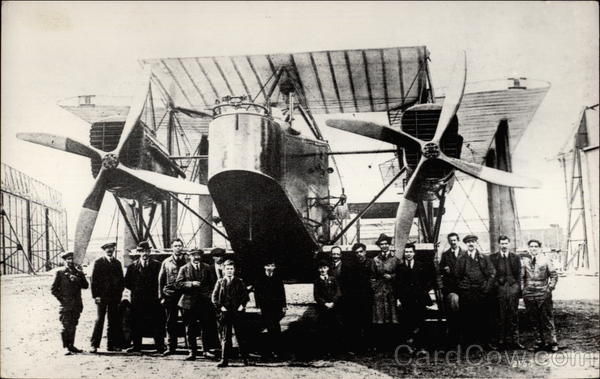 Group of men in front of airplane Aircraft