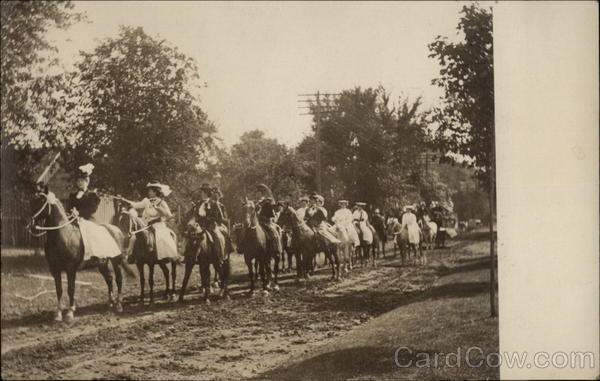Women riding horses in parade