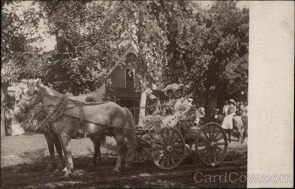 Women in a cart pulled by horses