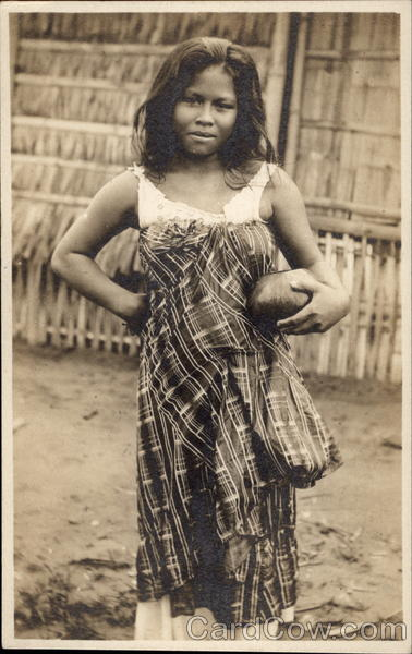 Native girl holding coconut bowl Puerto Rico