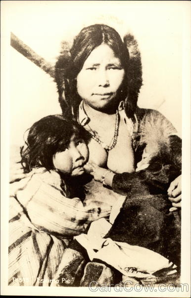 Indian woman nursing children Native Americana