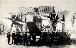 Group of men in front of airplane