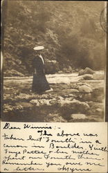 Woman standing in canon on river