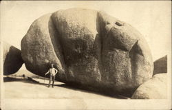 Man before a large rock