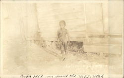 1919 Nude Cuban boy outside of home