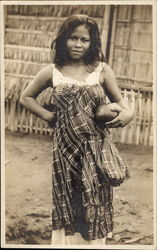 Native girl holding coconut bowl