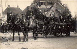 Horses pulling cart with band in parade