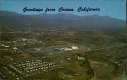 Aerial View of Covina area showing snow capped Mt. Baldy and the San Bernadino Freeway
