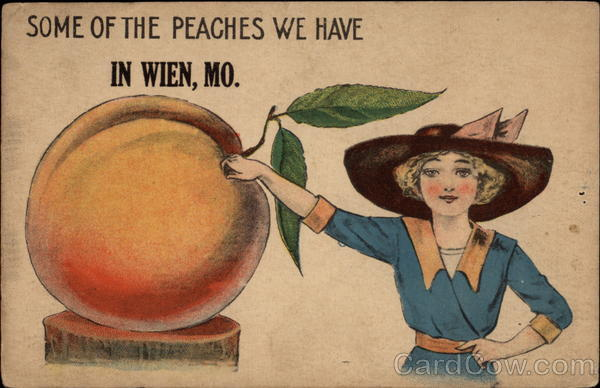 Pretty woman stands near a very large peach Exaggeration