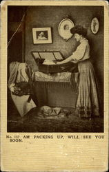 A lady packs a suitcase Postcard