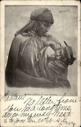 Native woman breast-feeding child